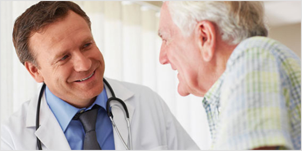 Old man talking with doctor